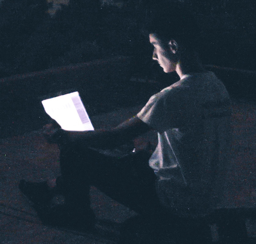 reading on ipad tablet in the dark, glowing screens